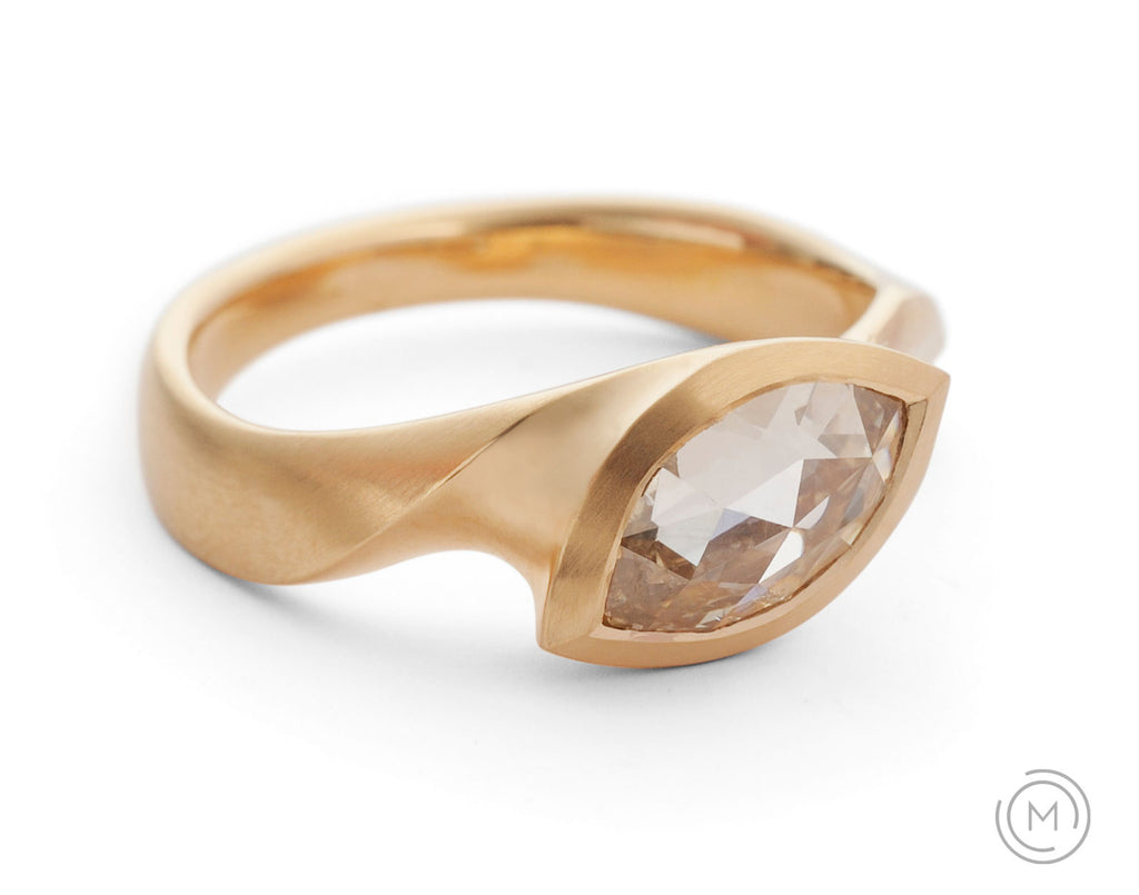 Carved rose gold solitaire engagement ring with marquise cognac diamond