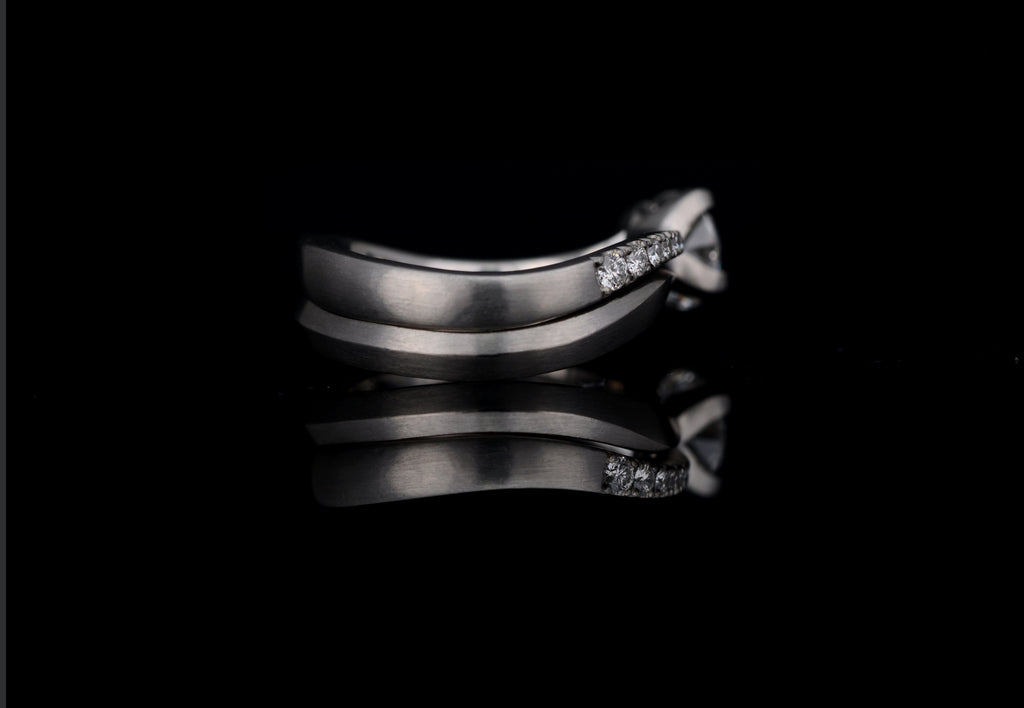 Platinum solitare engagement ring with matching wedding band.