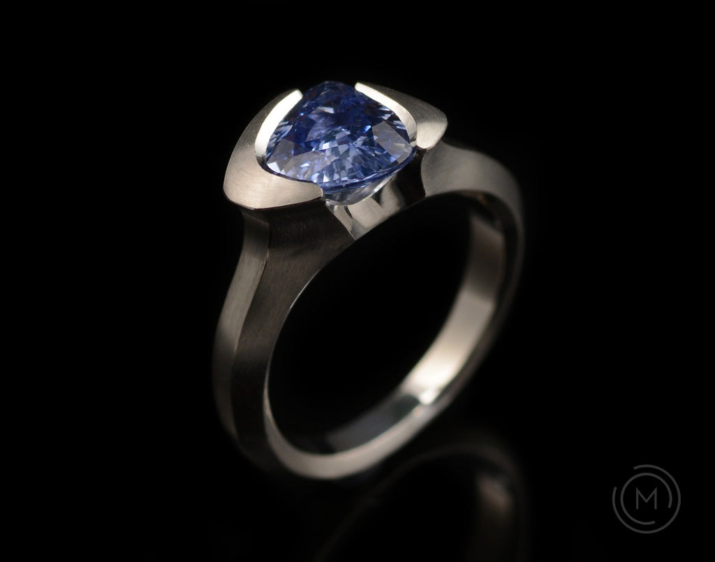 Bespoke sapphire and platinum hand-carved Arris ring