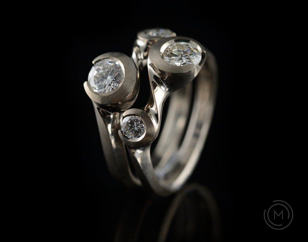 Bespoke Arris hand-carved platinum and diamond interlocking ring set