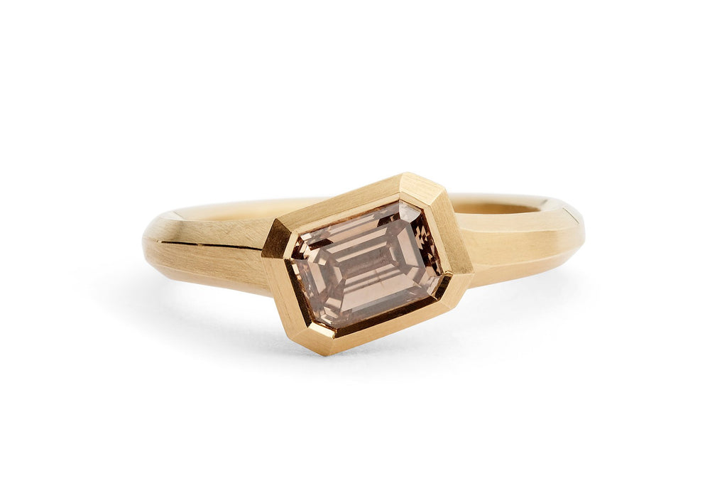 Rose gold and emerald-cut cognac diamond engagement ring