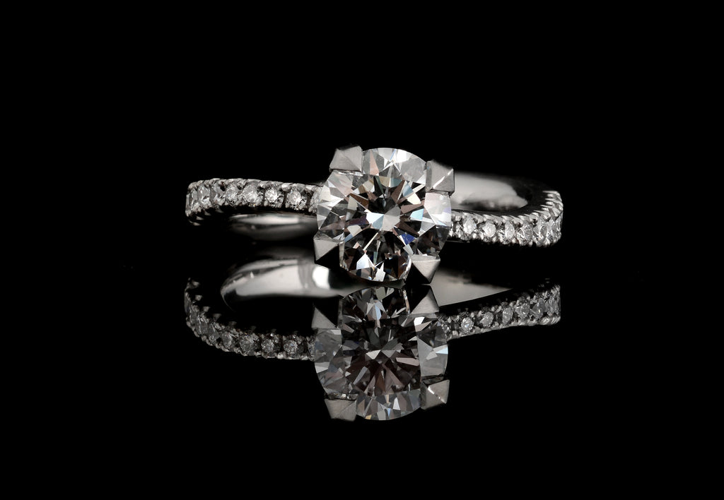 Final engagement ring with diamond set shoulders
