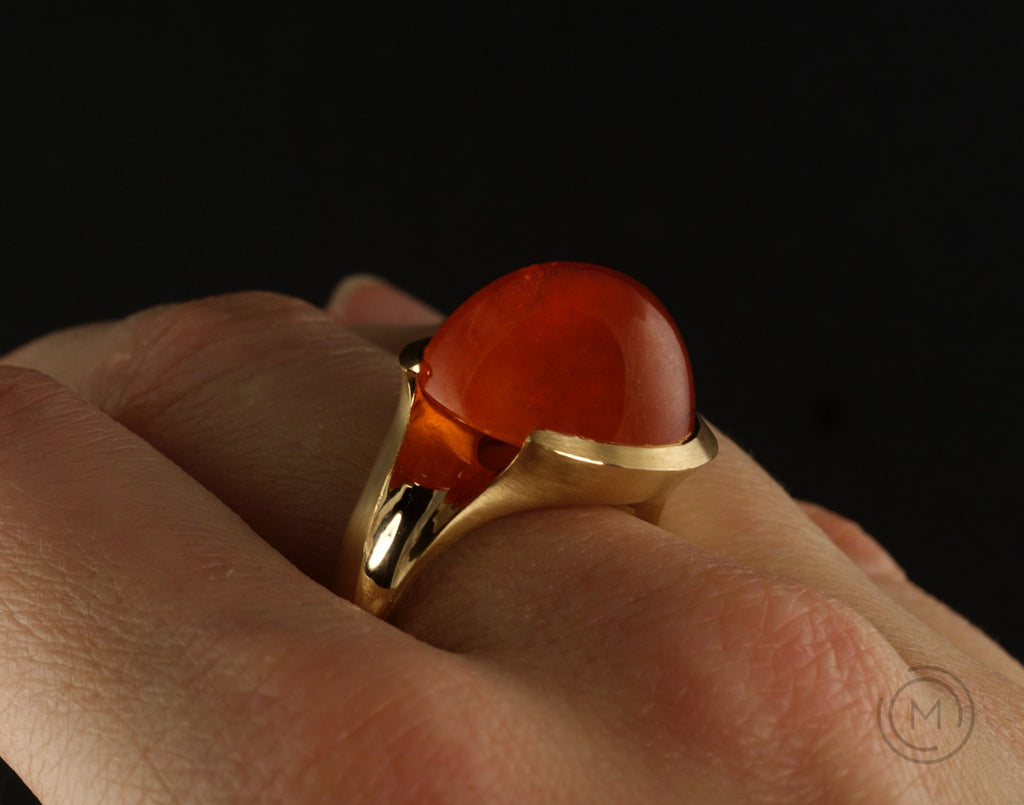 Rose gold hand-carved Arris ring with large cabochon garnet