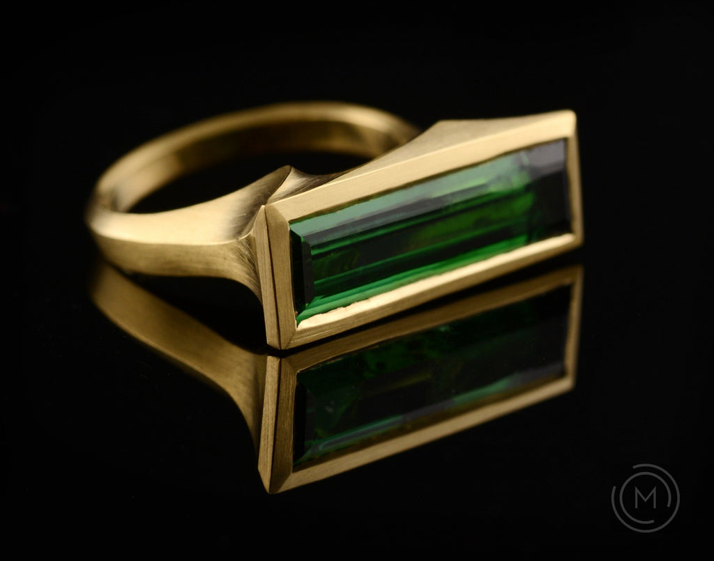 Arris hand-carved gold cocktail ring with green baguette tourmaline