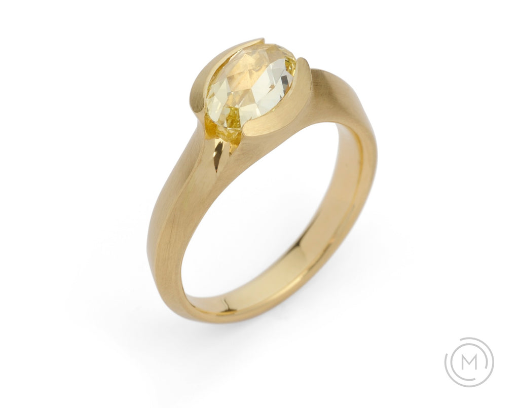 Carved gold and yellow diamond solitaire engagement ring on hand