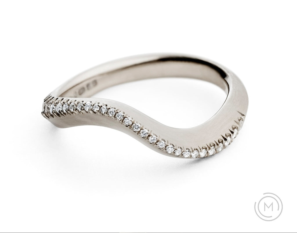 Carved white gold and diamond engagement and wedding ring in one