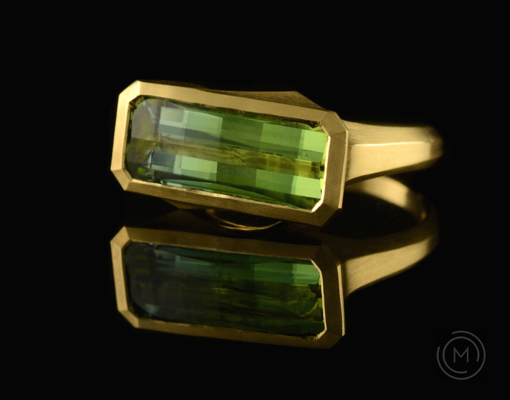 Arris hand-carved cocktail ring with fancy green tourmaline