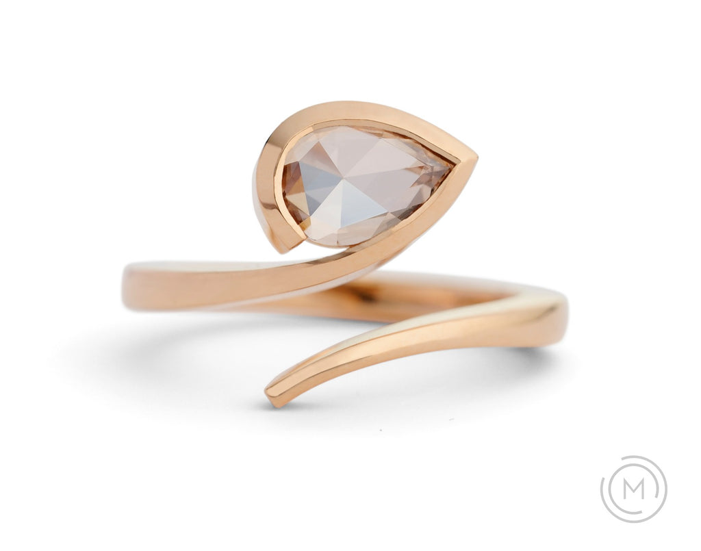 Rose gold contemporary engagement ring with pear cognac diamond
