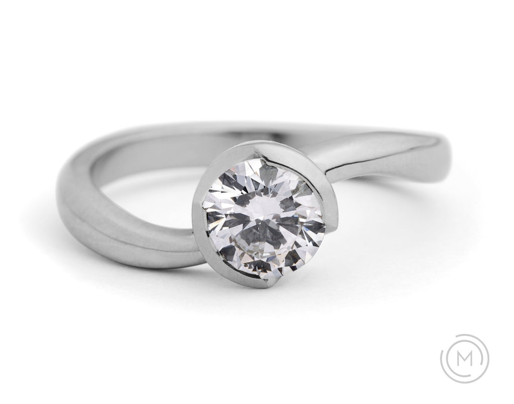 Contemporary platinum and white diamond engagement ring with curved band