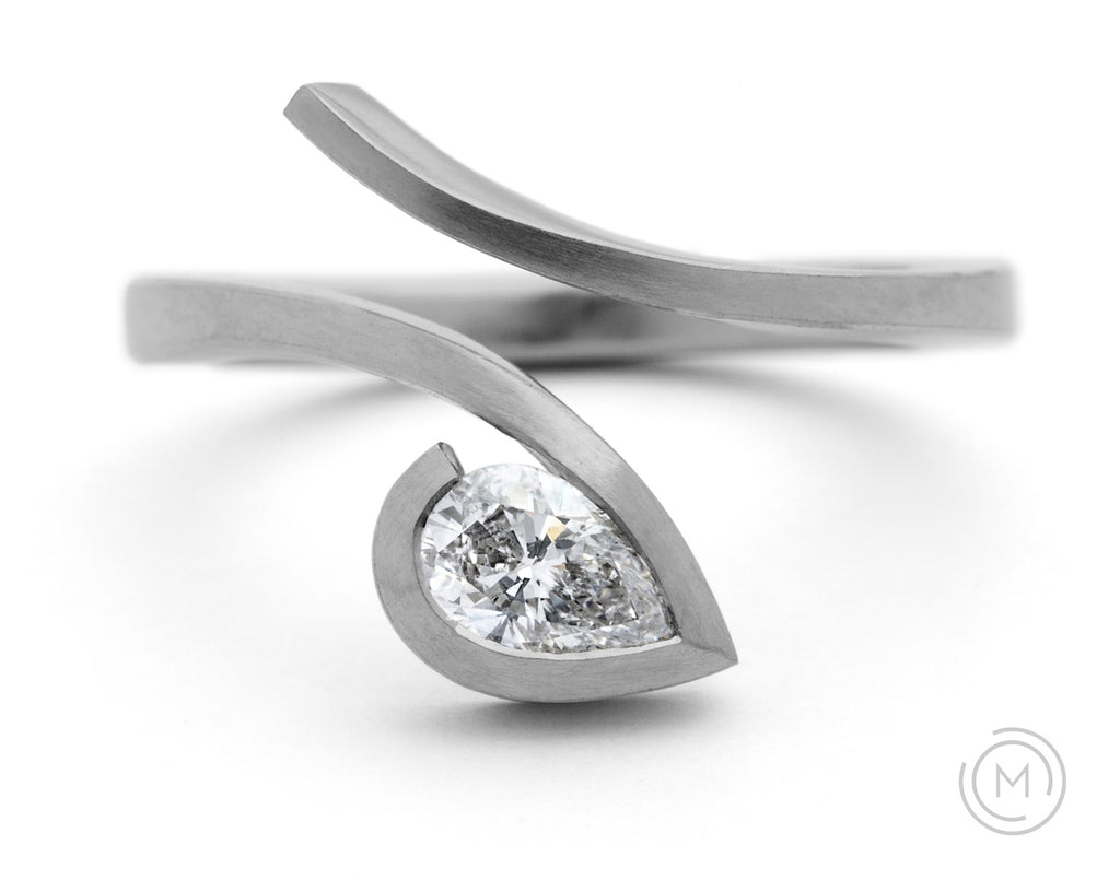 Contemporary platinum and white pear diamond engagement ring