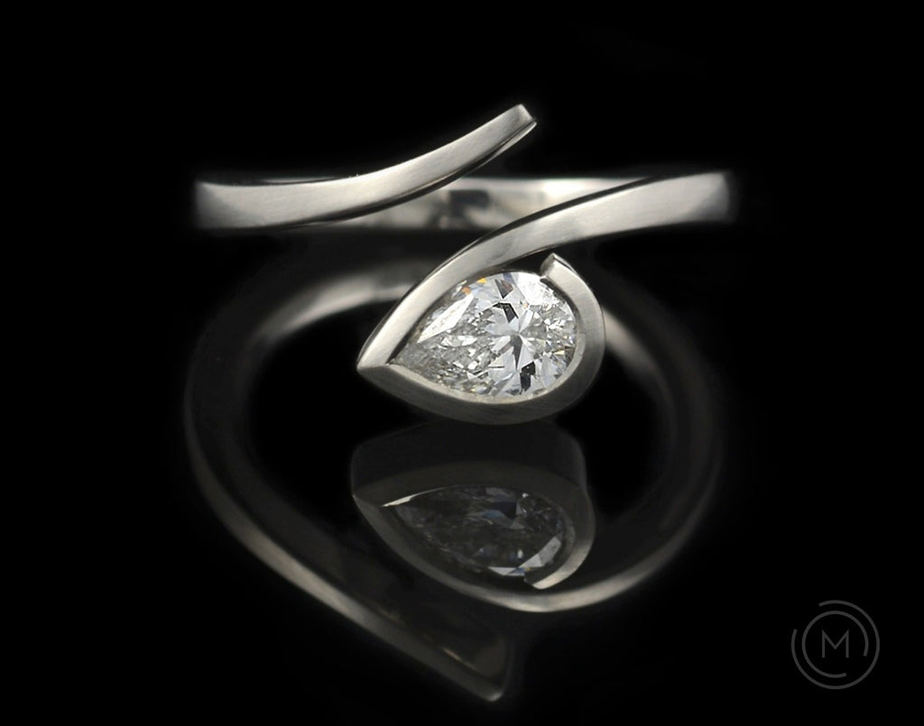 'Twist' platinum and pear white diamond contemporary engagement ring