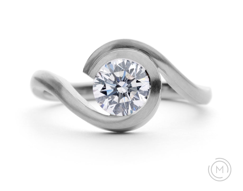 Brushed platinum and round white diamond contemporary engagement ring