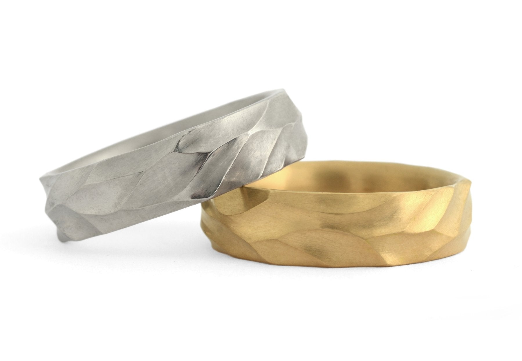 Hand-carved Dune men's wedding bands in yellow gold and platinum