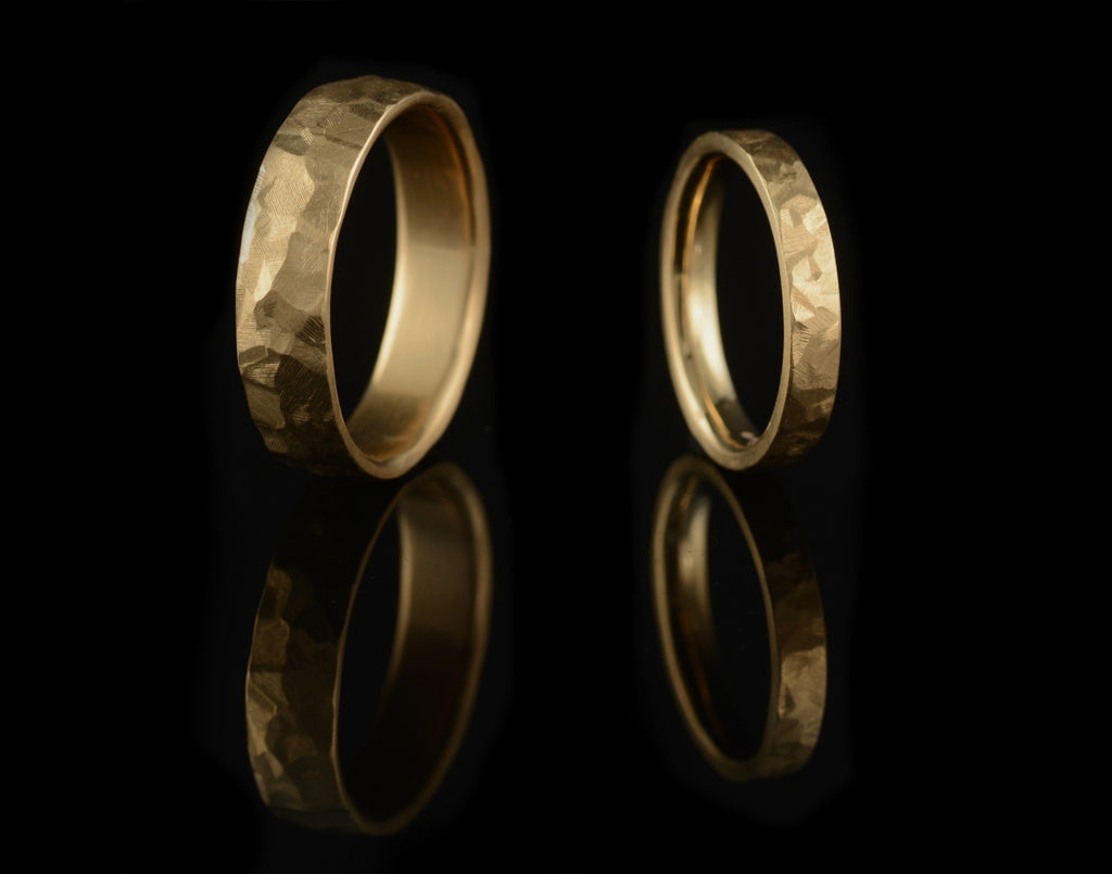 Flat or curved hammered gold wedding bands