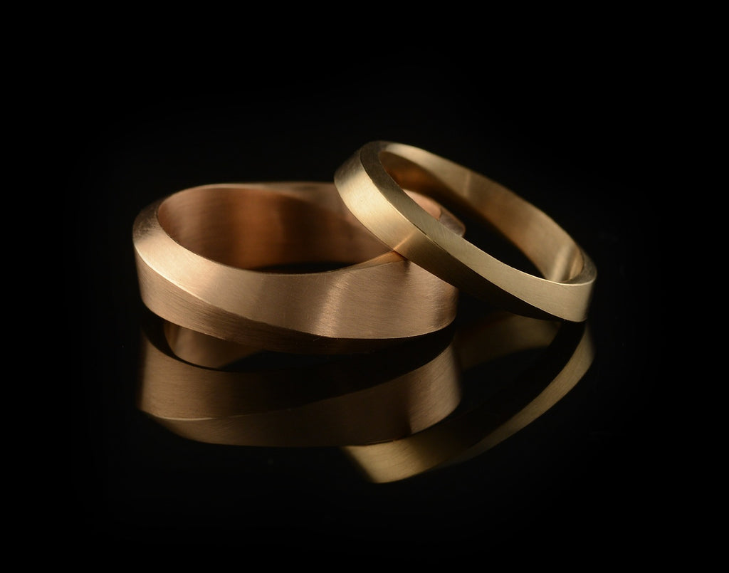 'Mobius' hand-carved rose gold mens wedding rings