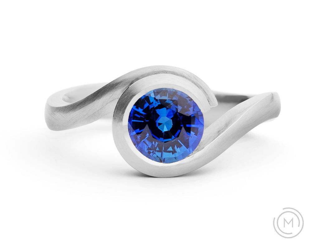 Modern platinum and blue sapphire engagement ring