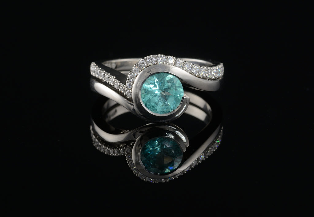 Paraiba tourmaline engagement ring with diamond set fitted band