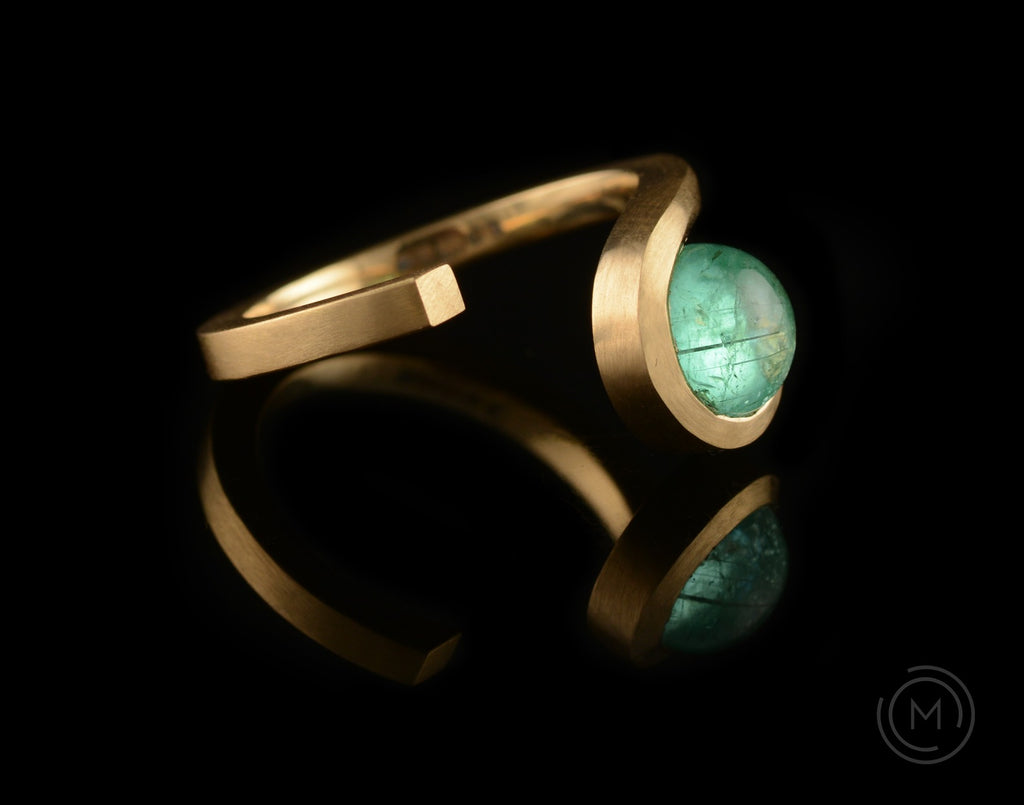 Yellow gold and round cabochon paraiba tourmaline engagement ring