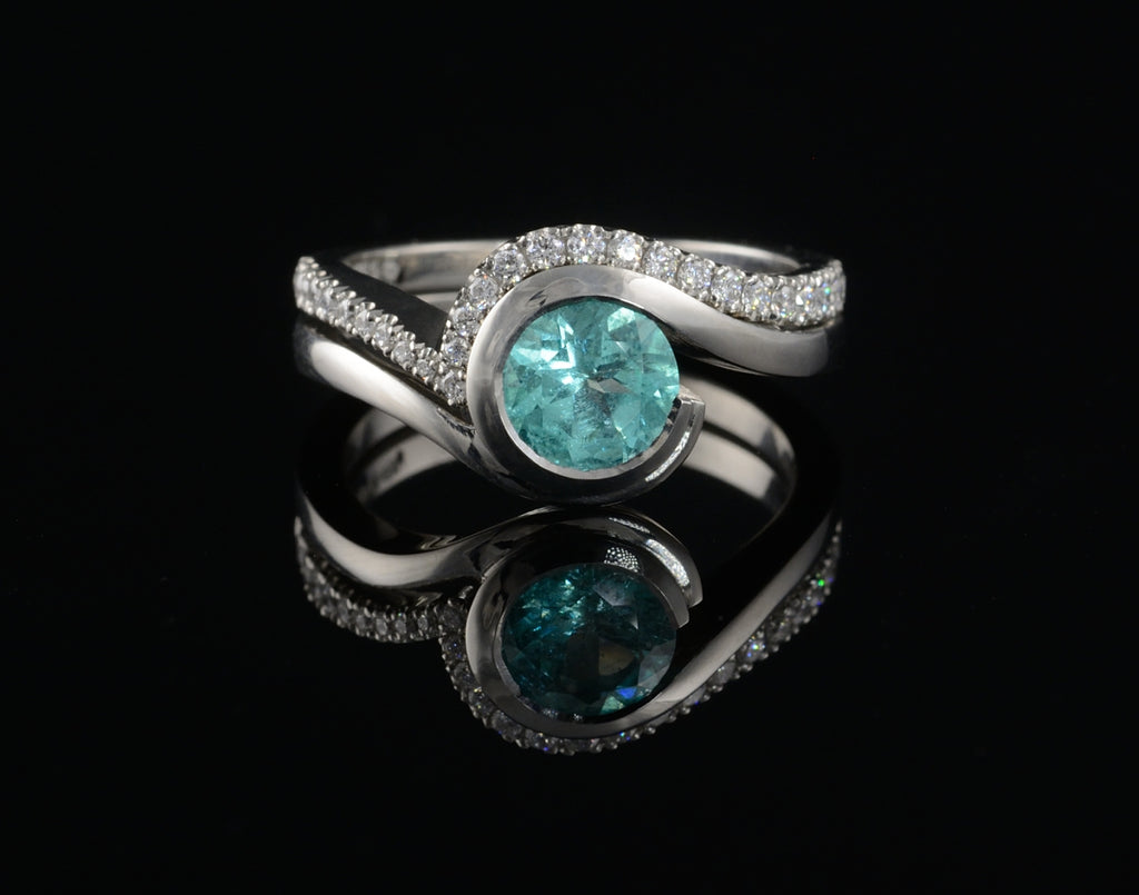 Blue paraiba tourmaline engagement ring with fitted diamond wedding band