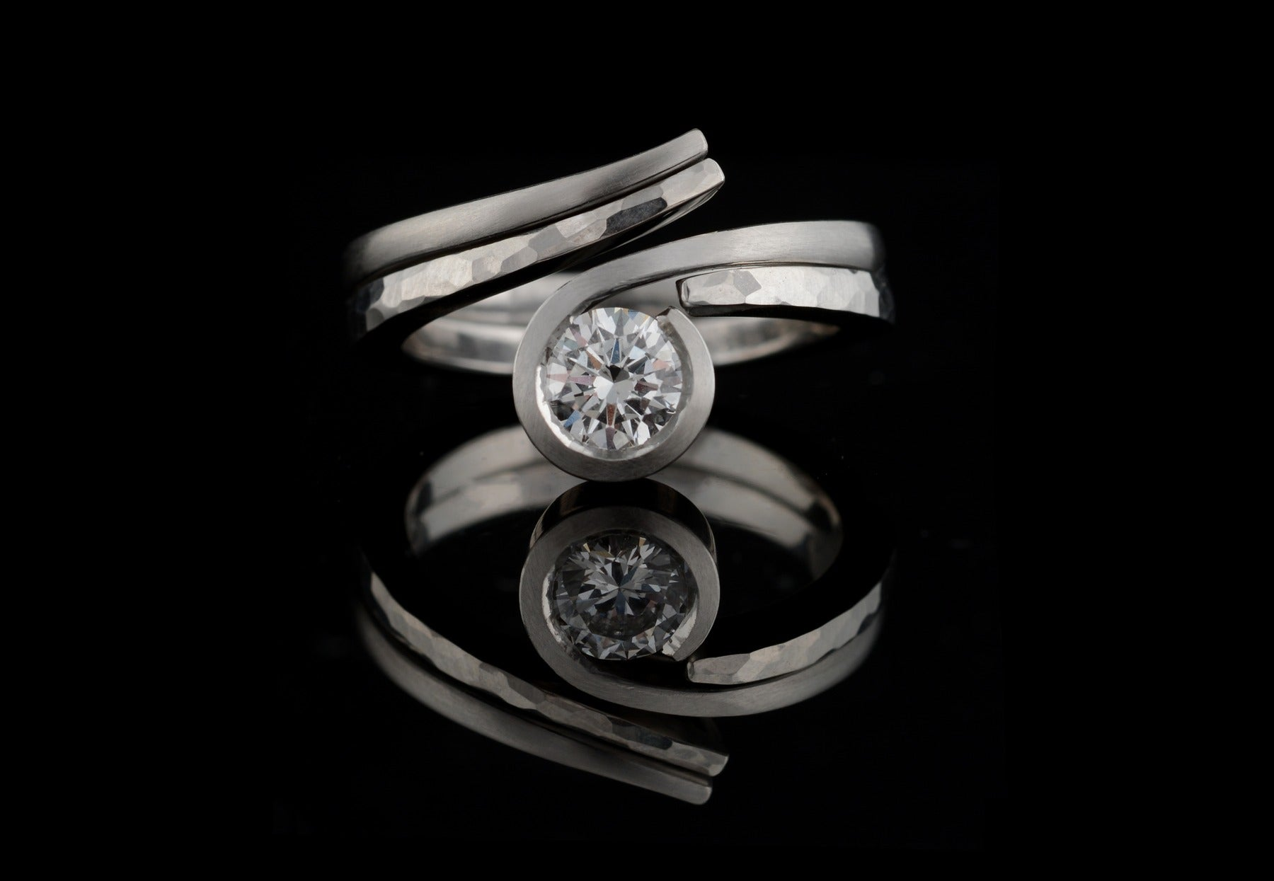 Twist platinum and diamond hammered engagement ring with fitted wedding band