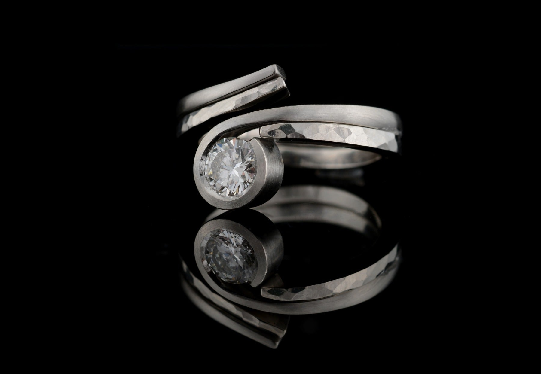 hammered fitted wedding band with twist engagement ring