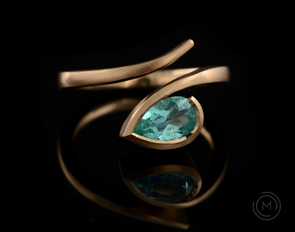 Hand-forged rose gold and pear paraiba tourmaline engagement ring