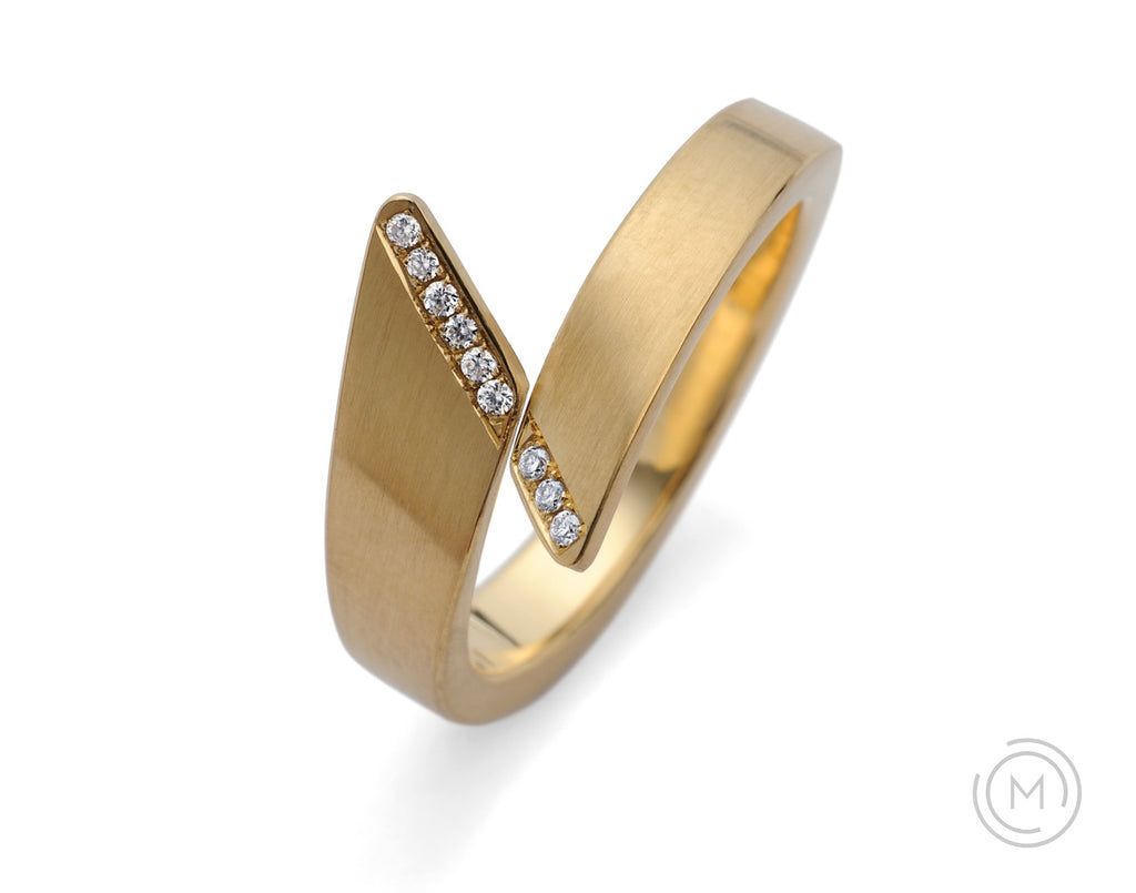 Forged gold all-in-one engagement and wedding ring with white diamonds