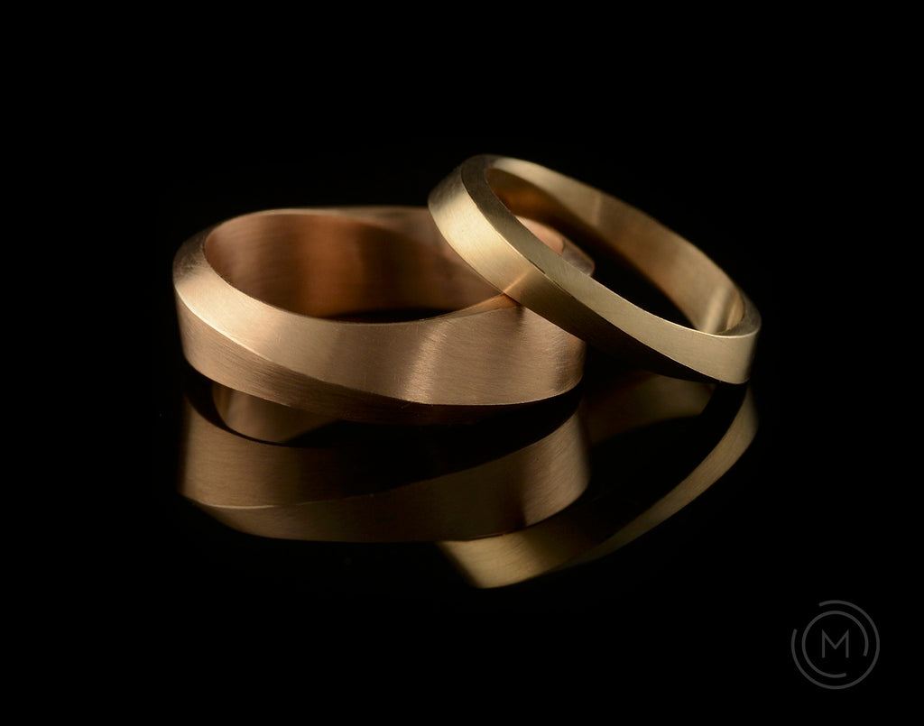 Unique 'Mobius' rose gold ladies wedding bands