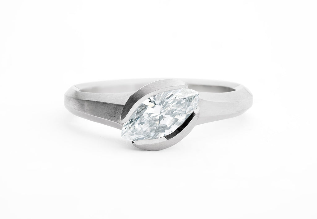 Unusual engagement ring in platinum and white marquise diamond
