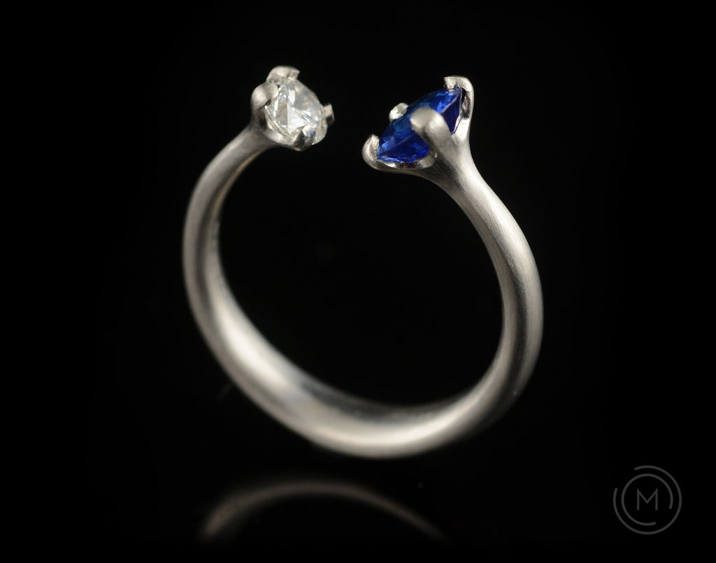 Unusual engagement ring with two stones diamond and sapphire