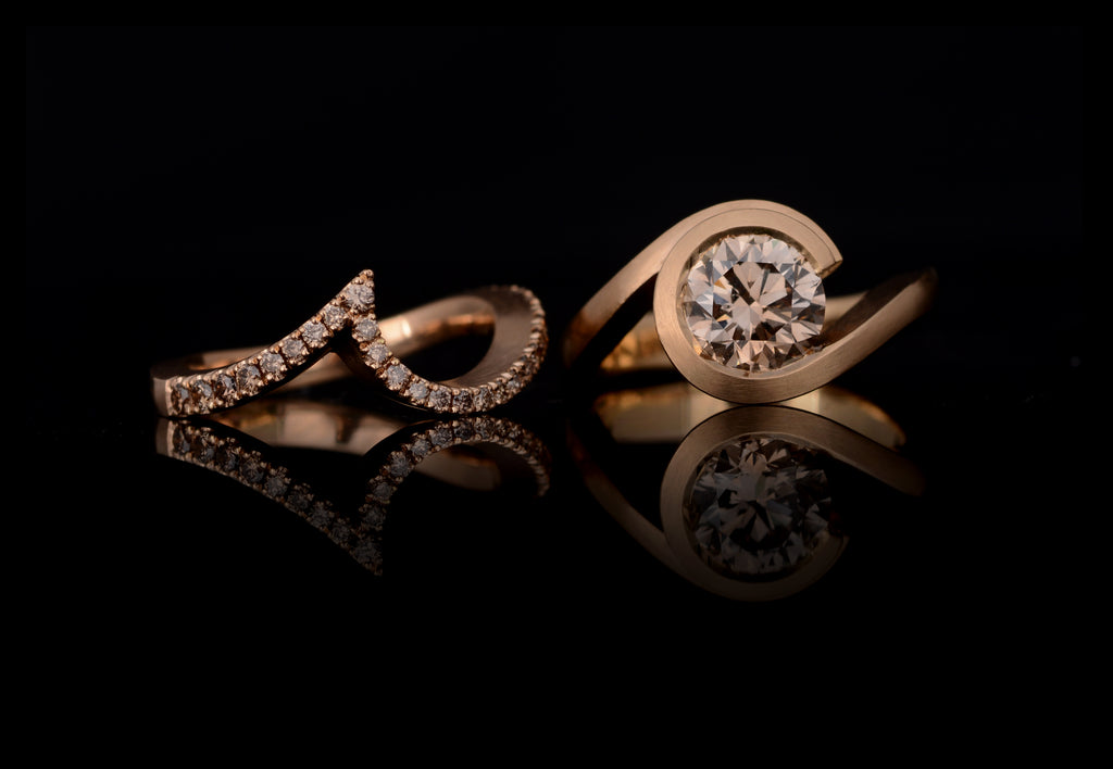 Rose gold fitted wedding band and wave engagement ring with cognac diamond.