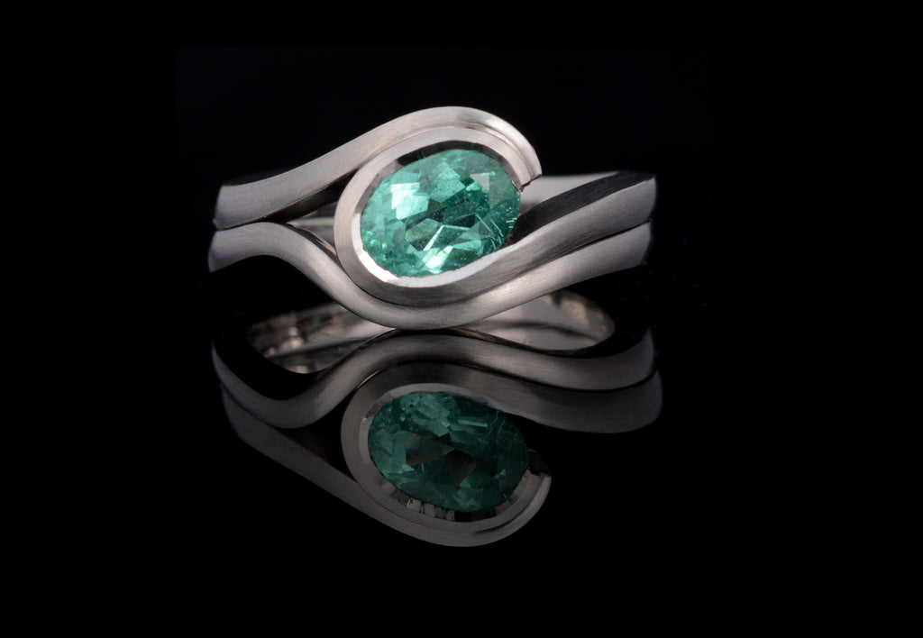 Paraiba wave engagement ring with fitted band