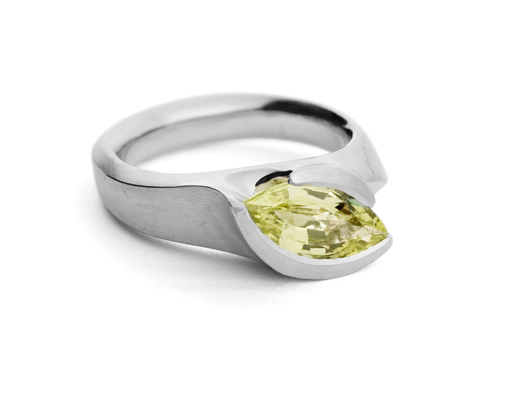 Unique engagement ring with large coloured stone