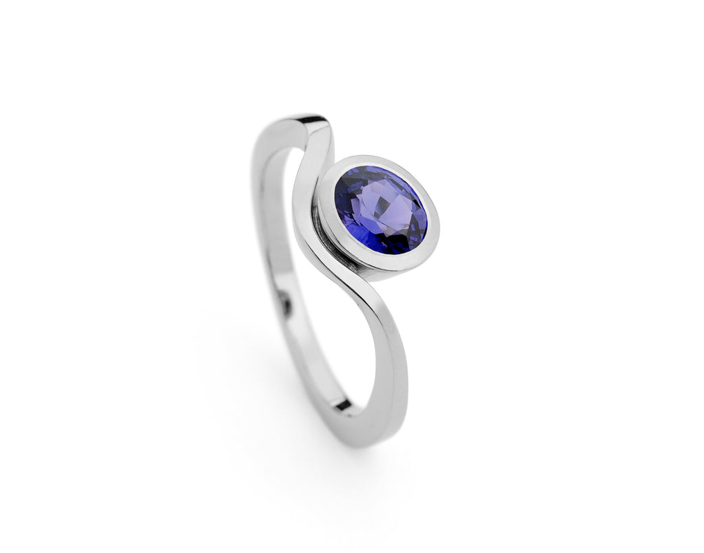 Blue coloured spinel gemstone engagement ring