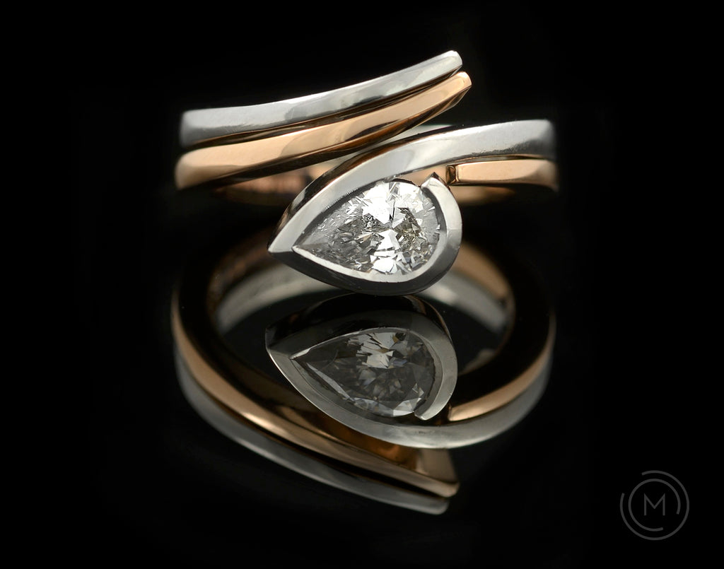 Contrasting rose and platinum fitted wedding and engagement rings