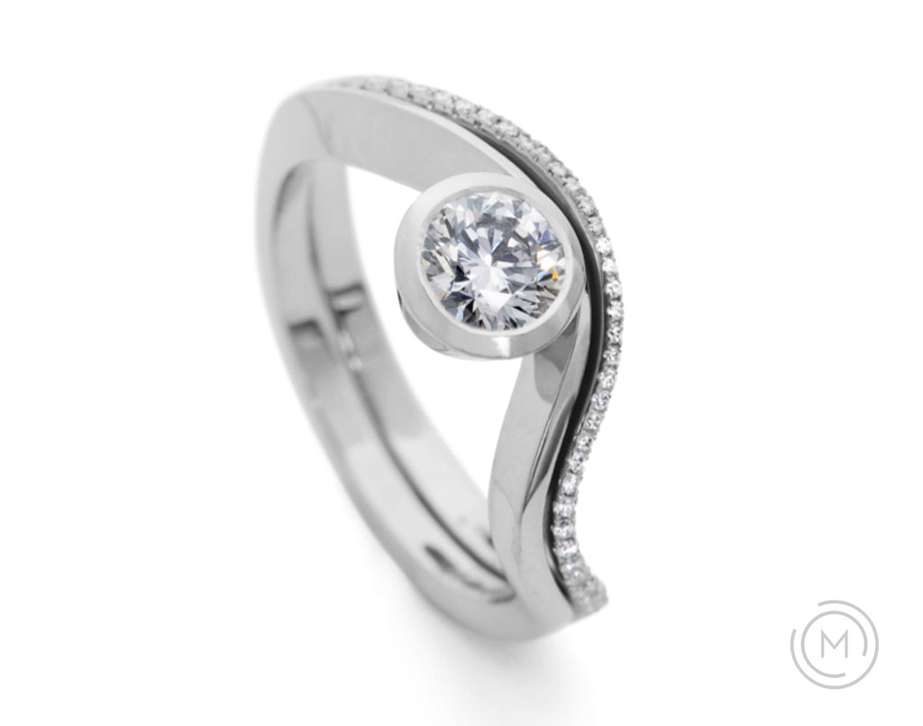 Curved fitted platinum wedding ring with white diamonds