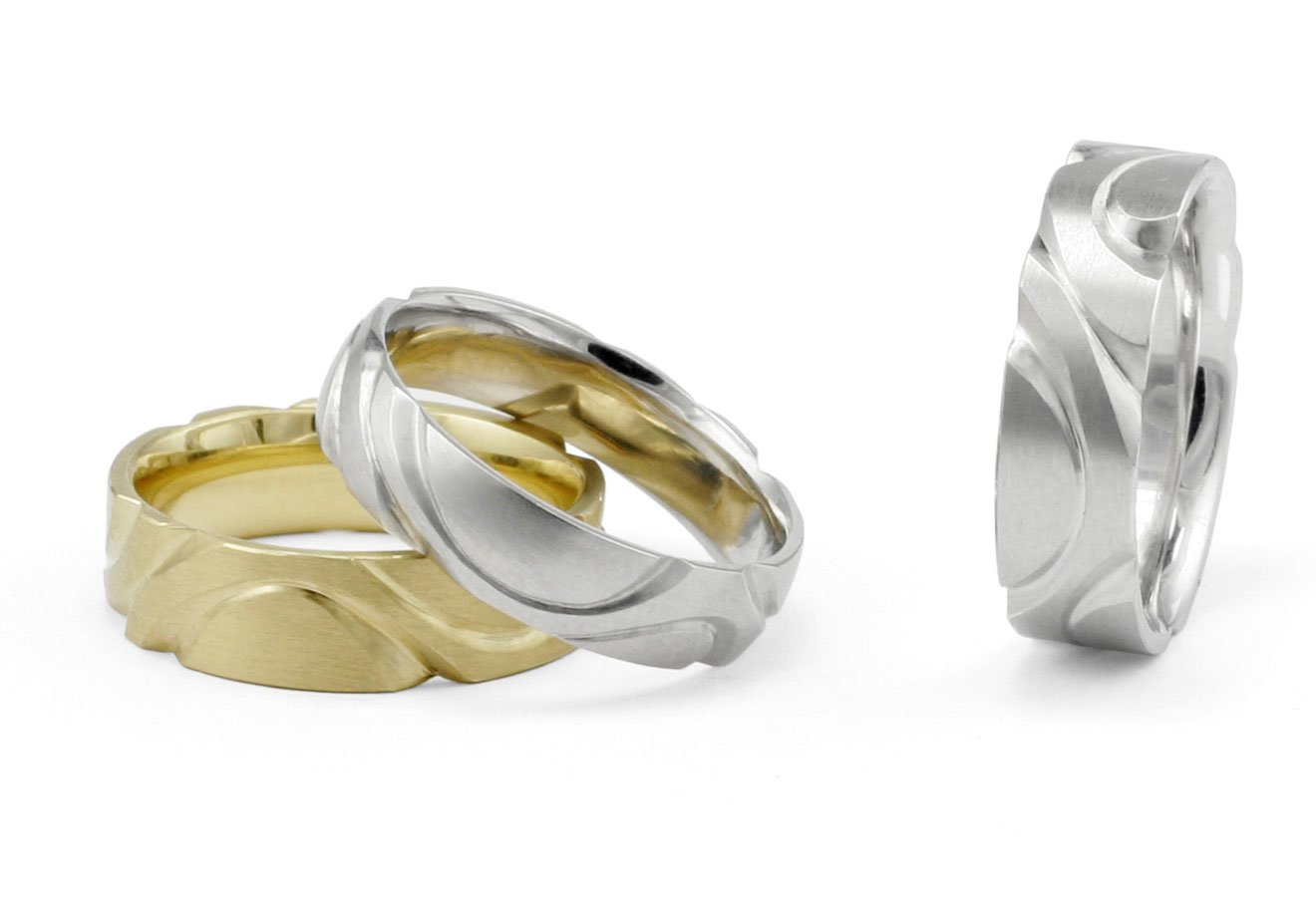 Unusual hand carved men's wedding bands in platinum and yellow gold