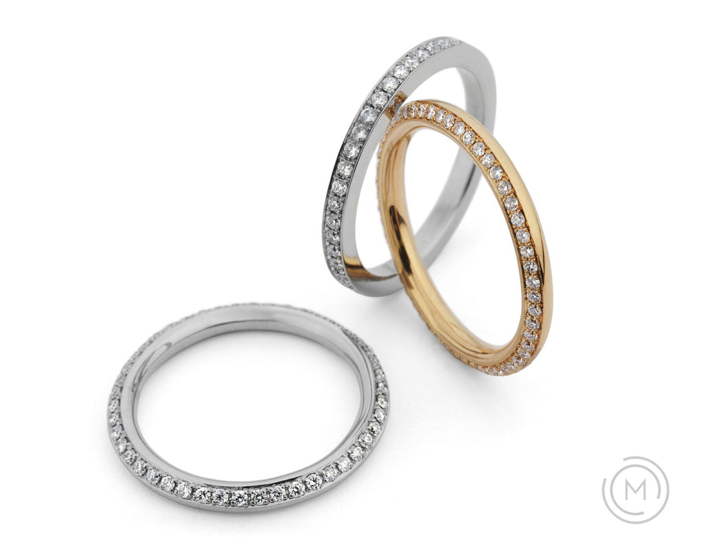 Eternal round gold and platinum diamond eternity rings