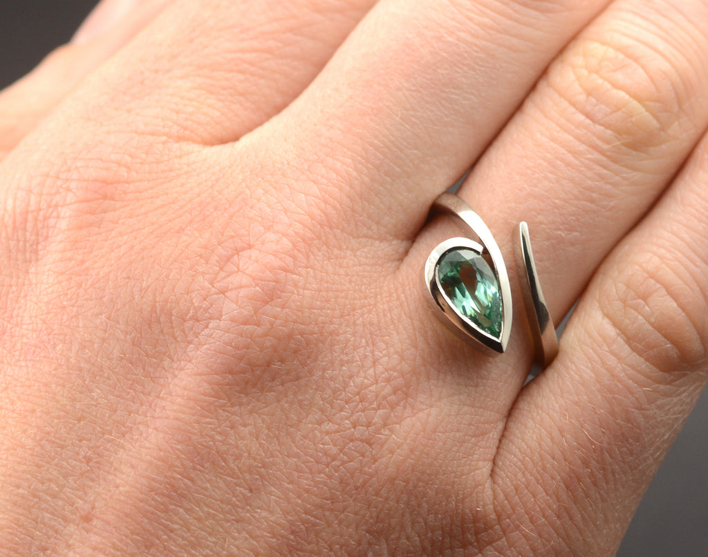 Unusual women's platinum engagement ring with pear gemstone