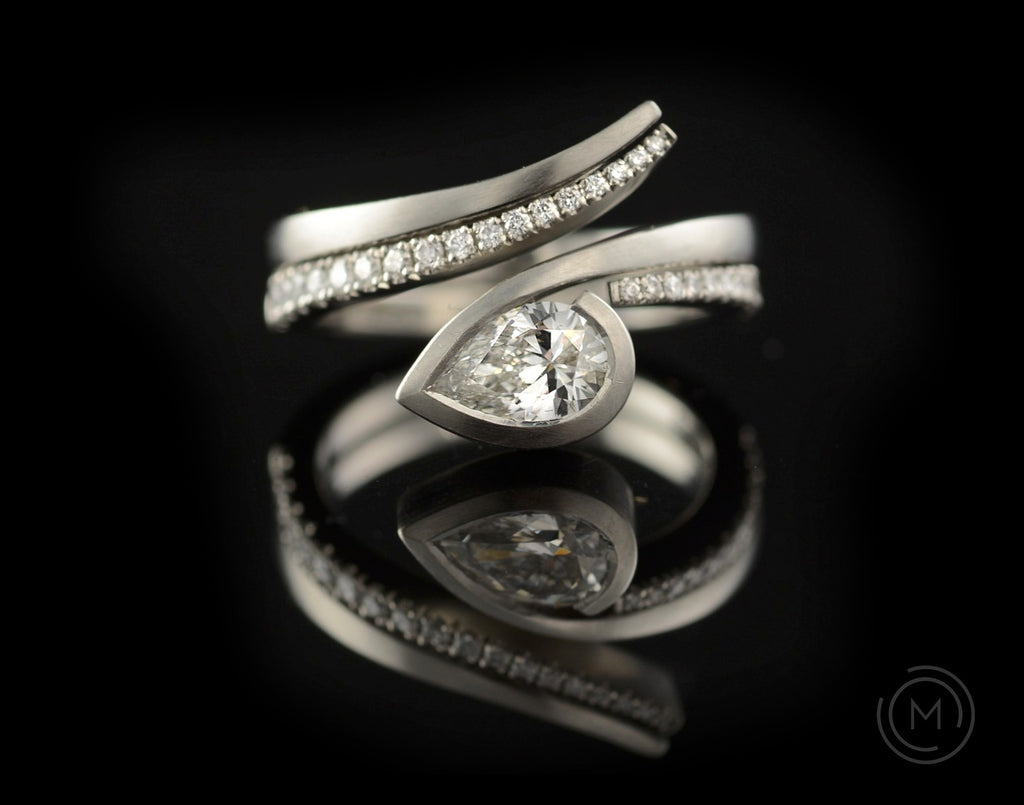 Fitted platinum engagement and wedding rings with white diamonds