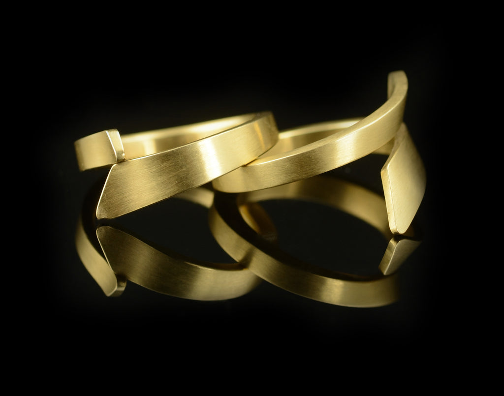 Unique hand-forged yellow gold ladies wedding bands