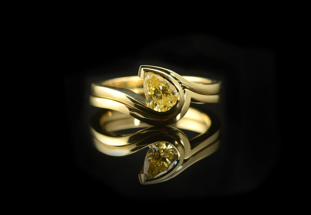 Fitted band for pear shaped yellow diamond wave engagement ring.