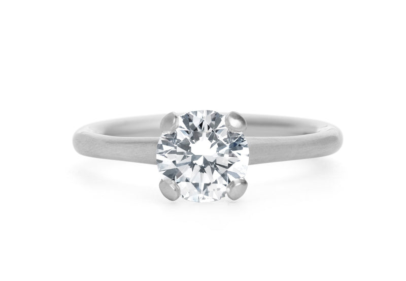 Brilliant cut white diamond and platinum 4 claw sculpted solitaire engagement ring