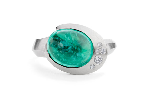 Carved platinum and Paraiba tourmaline Arris cocktail ring with diamonds