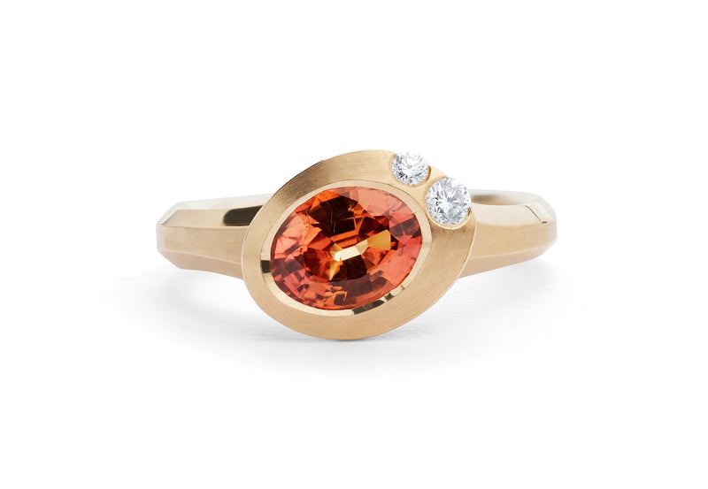 Arris carved rose gold ring with oval orange sapphire and white diamonds