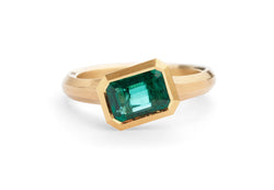 Arris hand carved yellow gold and emerald engagement ring
