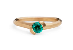 Hand carved asymmetrical rose gold arris ring with emerald