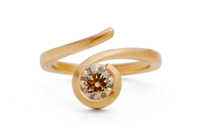 Contemporary 'Twist' 18 carat rose gold and round cognac diamond engagement ring