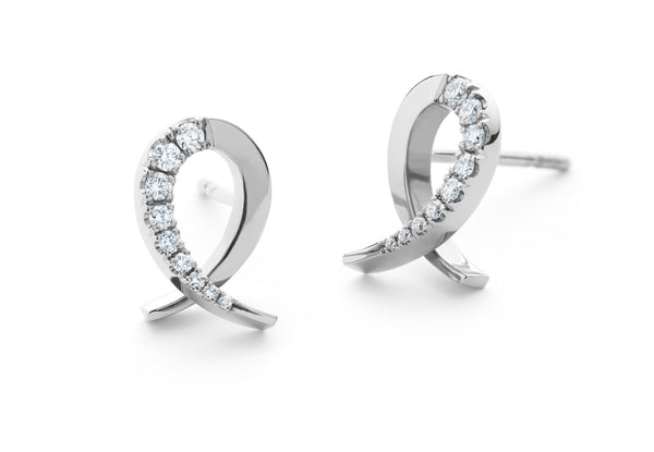Forged white gold and diamond stud earrings