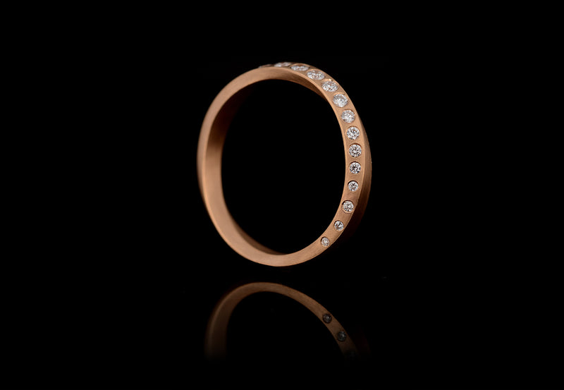 White round diamond Mobius ring rose gold